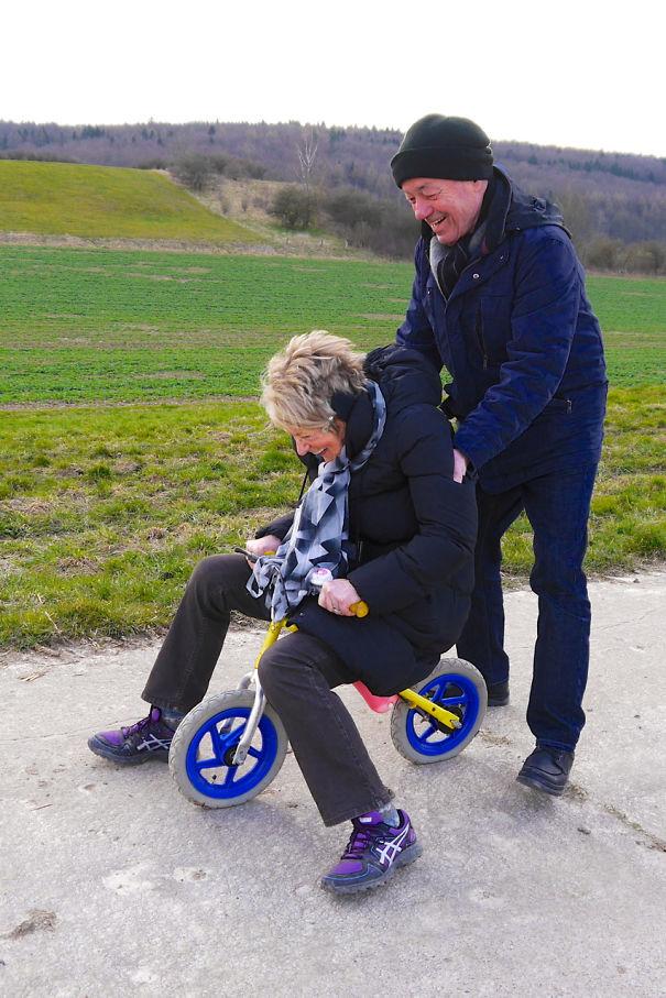 Having Fun With Their Grandson's Balance Bike