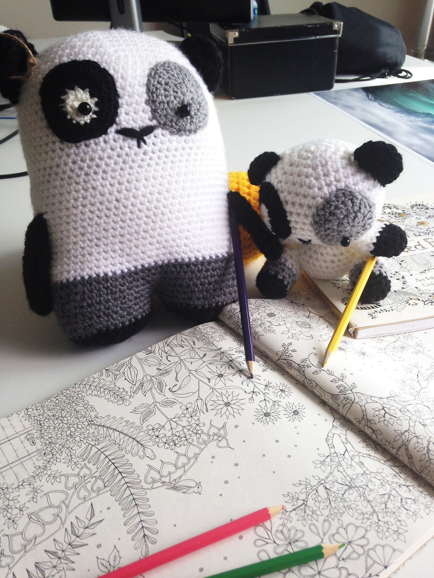 Pandas Enjoying Their Coloring Book