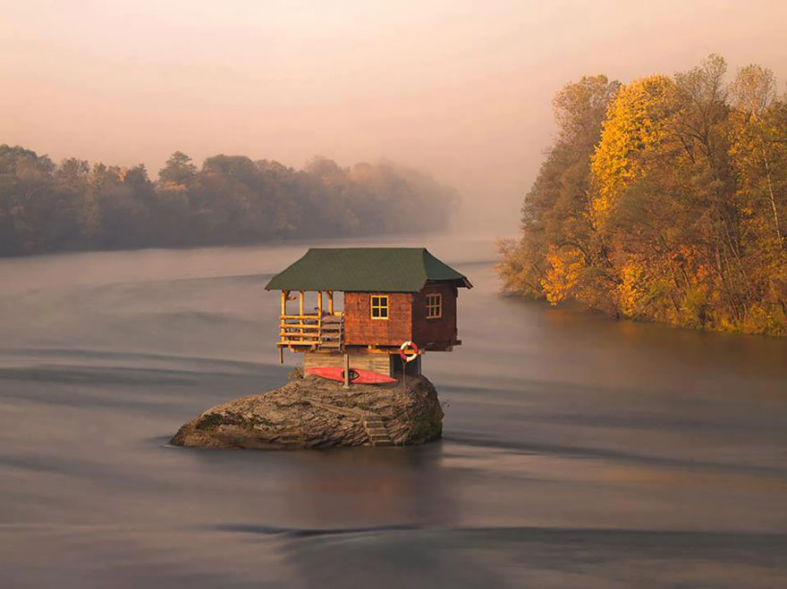 House Balancing On Rock In Serbia