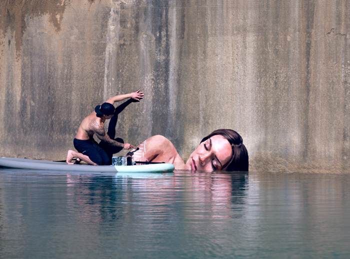 Artist Paints Stunning Seaside Murals While Balancing On A Surfboard