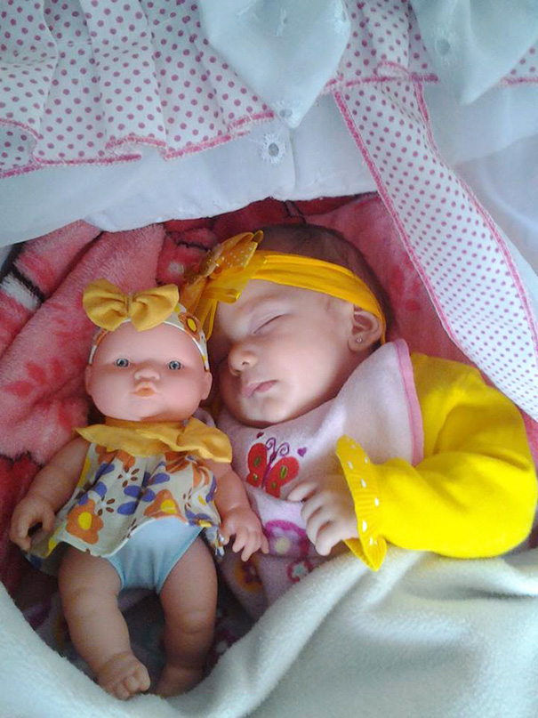 Baby With Her Look Alike Doll