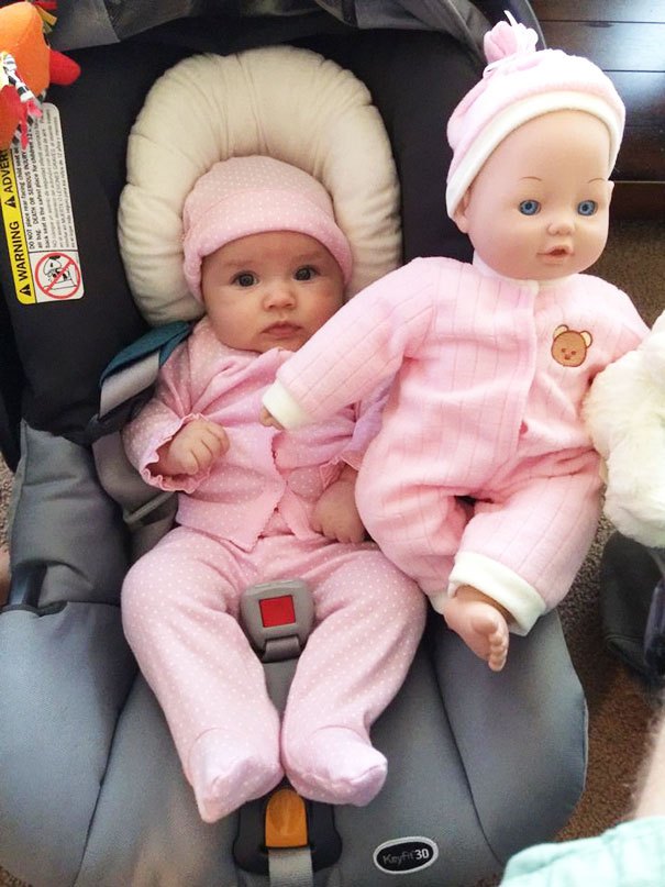 Baby Girl With Her Look Alike Doll