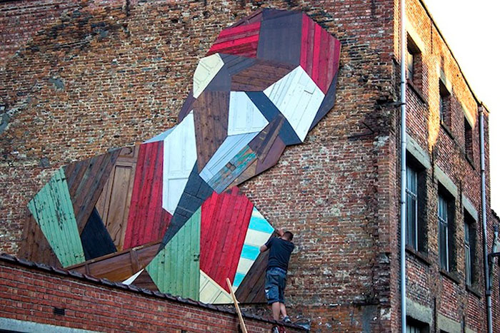Artist Turns Old Wooden Doors Into Giant Street Art Murals
