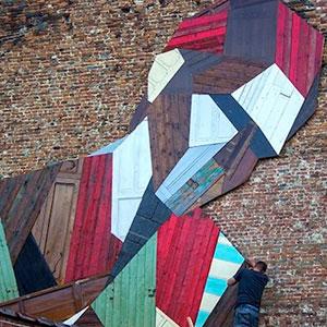 Artist Turns Old Wooden Doors Into Giant Street Art Murals