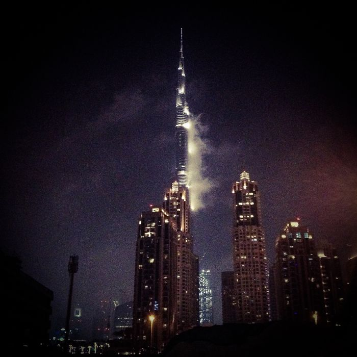 Condensation On Burj Khalifa In Dubai Forms Face & Hair