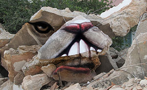 Street Artist Turns Rocks And Ruins Into Faces