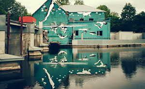 This Mural Was Painted Upside-Down To Reflect Off Of The Water