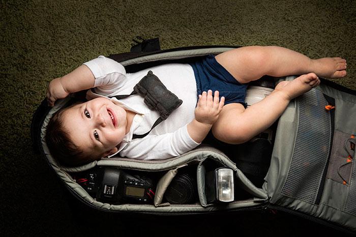 Child In Camera Bag