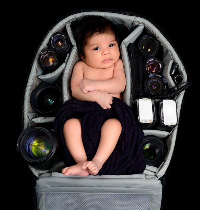 Baby In Camera Bag