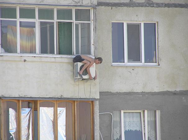 Man Balanced On Ventilation Unit