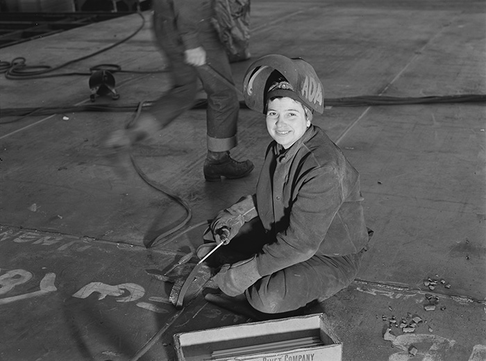 This Woman Worker Pushes Back Her Helmet During A Moment's Pause From Her Welding Job At The Richmond Shipyard In California (1943)
