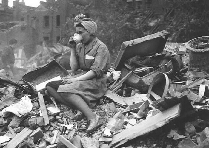 A Woman Drinking Tea, In The Aftermath Of A German Bombing Raid During The London Blitz (1940)