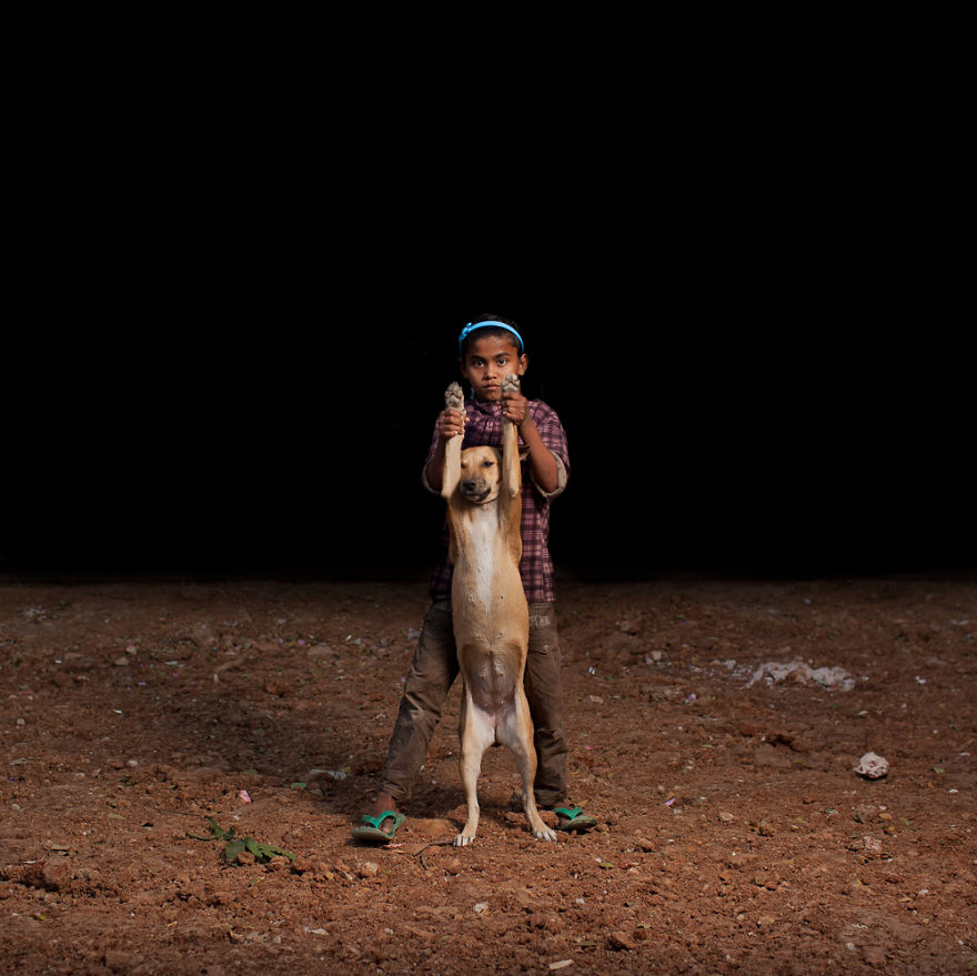 These 10 Orphan Boys Chose To Share The Little Food They Have With 10 Dogs They Adopted
