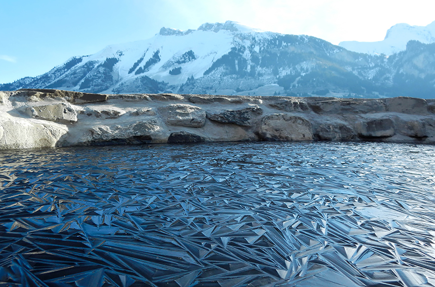 Frozen Pond In Switzerland