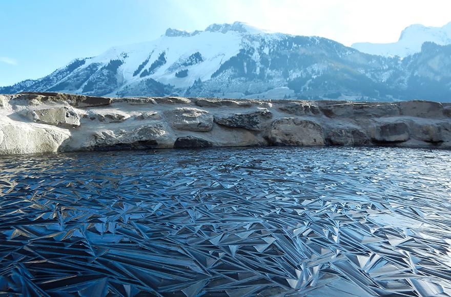Frozen Pond In Switzerland