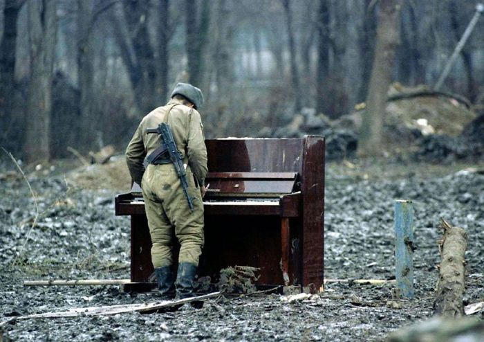 A Russian Soldier Playing An Abandoned Piano In Chechnya In 1994.