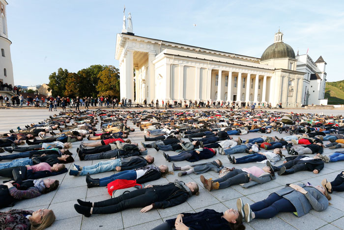 After Losing 8 Friends To Suicide, I Invited People To Lie Down In Lithuania To Show The Suicide Rate