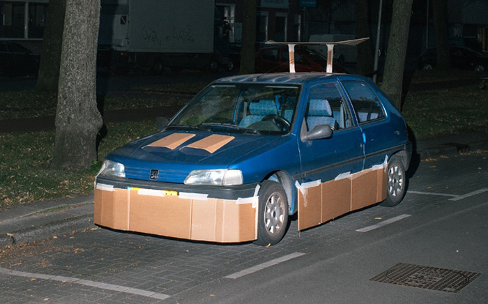 This Guy Walks Around At Night Pimping Random People's Cars With Cardboard
