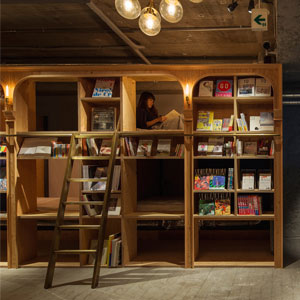 Bookstore-Themed Tokyo Hotel Has 1,700 Books And Sleeping Shelves Next To Them