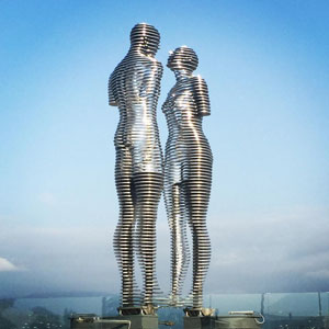 Moving Statues Of A Man And Woman Pass Through Each Other Daily, Symbolizing Tragic Love Story