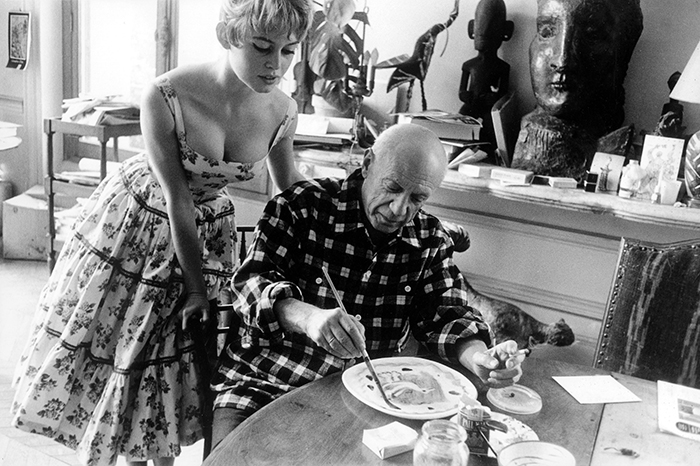 Actress Brigitte Bardot Watching Pablo Picasso At Work In His Studio In Vallauris (1956)