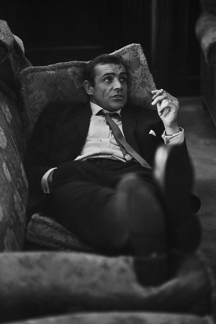 A Young Sean Connery Smoking A Cigar