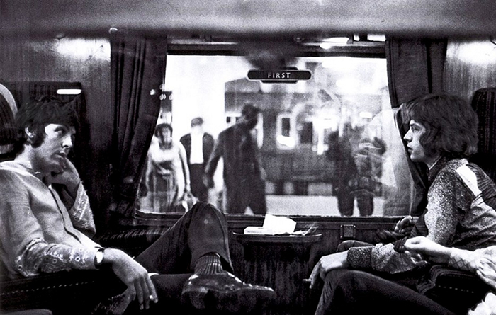 Paul McCartney Of The Beatles And Mick Jagger Of The Rolling Stones Sit Opposite Each Other On A Train At Euston Station (1967)