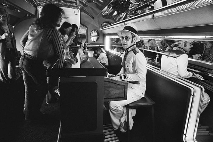 Elton John At His Piano Bar Aboard His Private Jet (1974)