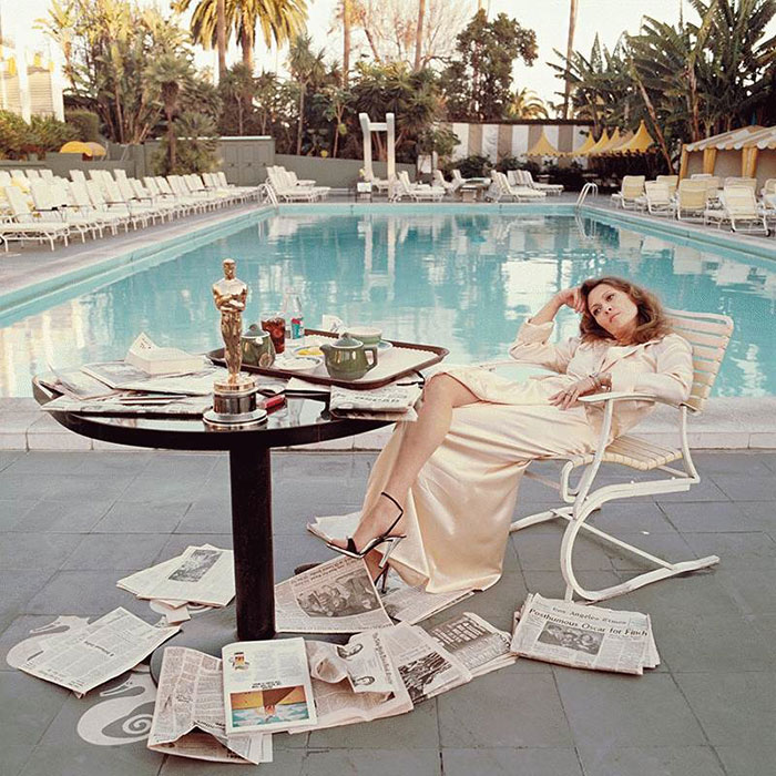 American Actress Faye Dunaway Takes Breakfast By The Pool With The Day's Newspapers (1977)