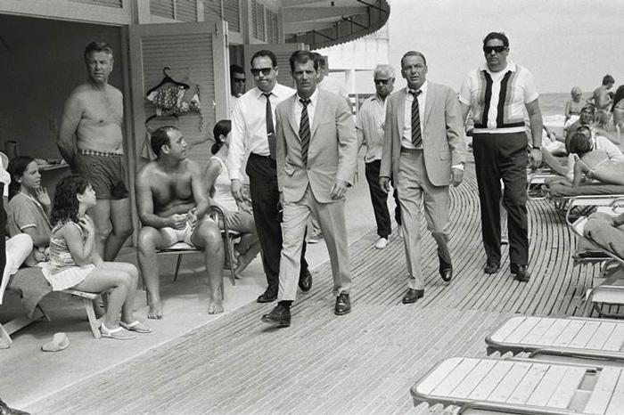 Frank Sinatra Arrives At Miami Beach With His Entourage (1968)