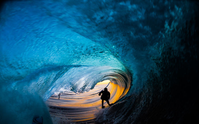 I Photograph Surfers From Inside Barrel Waves At Night