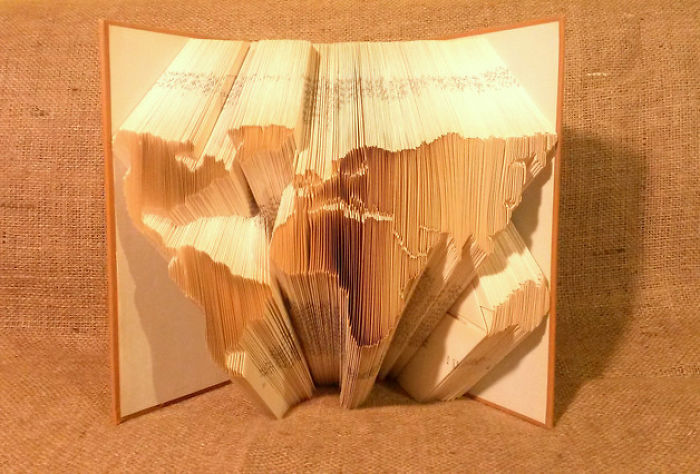 Peter Gives A New Life To Books By Making Origami Sculptures