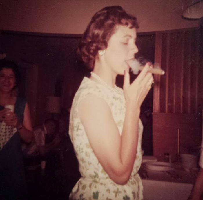 Young Woman Smoking A Cigar; Circa. 1950
