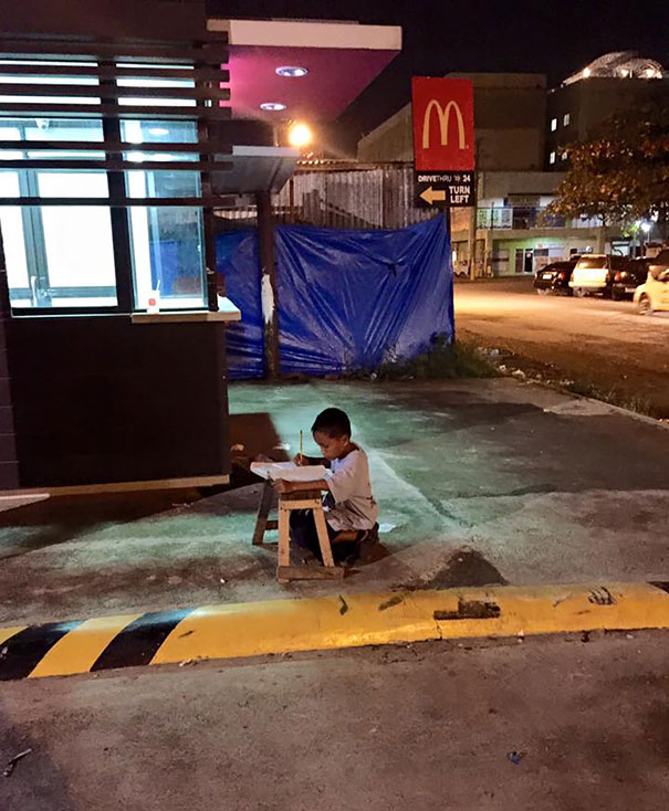 Homeless Boy Does His Homework Using The Light From A Local Mcdonald's