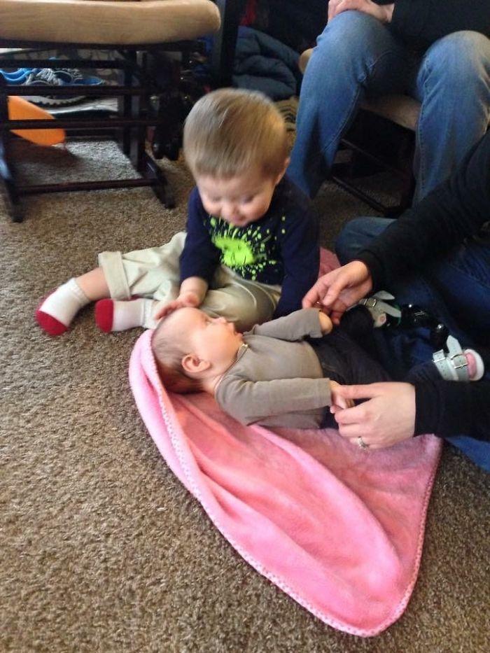 Niece Has Arthrogryposis, My Son Rubs Her Head & Gives Hugs/kisses.always So Concerned.