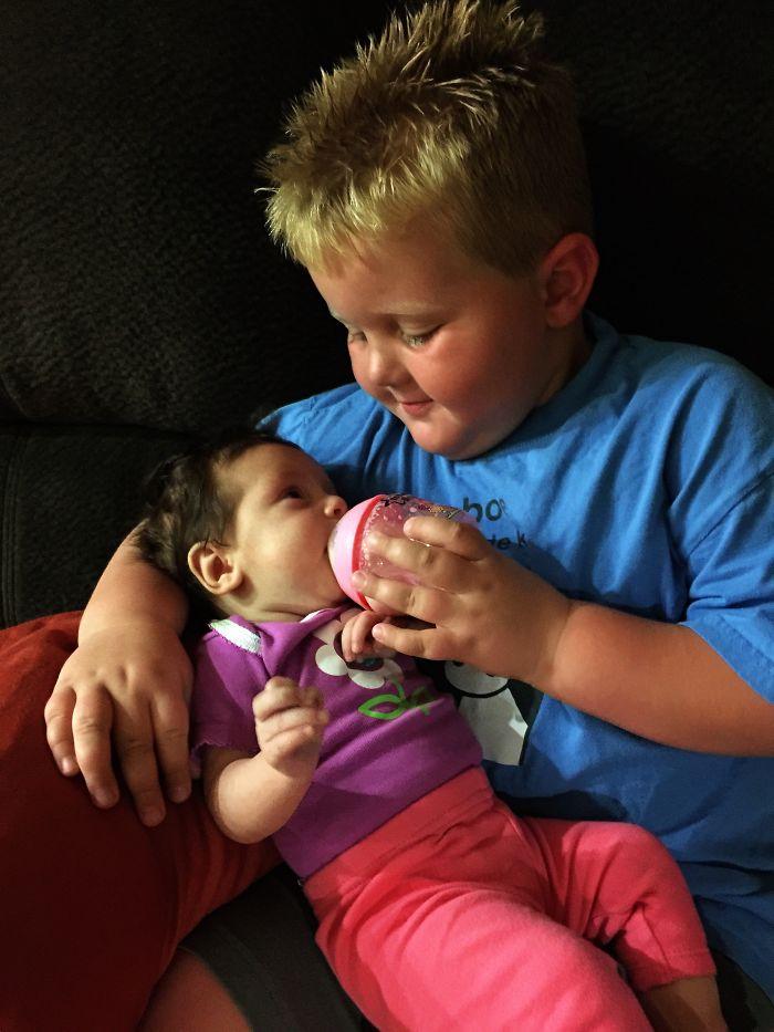 My Son Lovingly Feeding His Little Sister