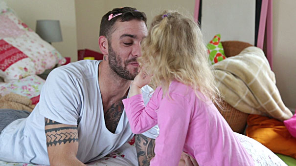 Little Girl Applying Make-Up To Her Daddy
