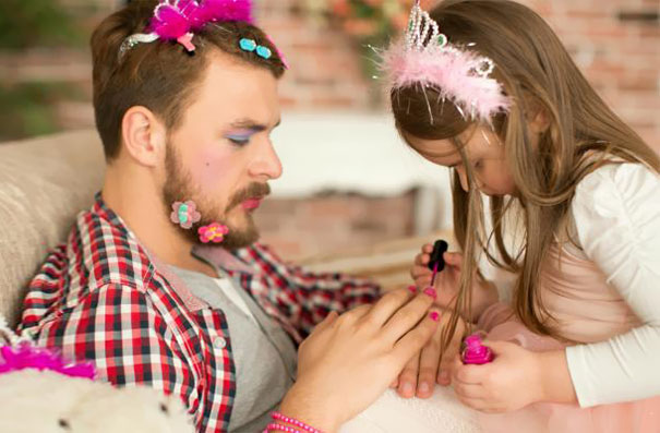 Cute Daughter Making Up Her Father