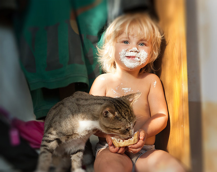 Kid With A Cat