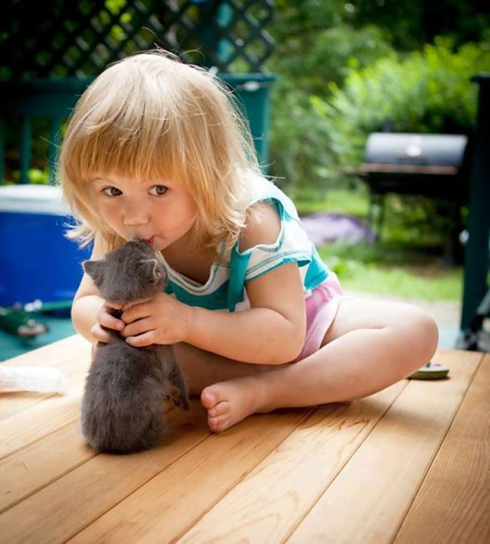 Girl Kissing Her Cat