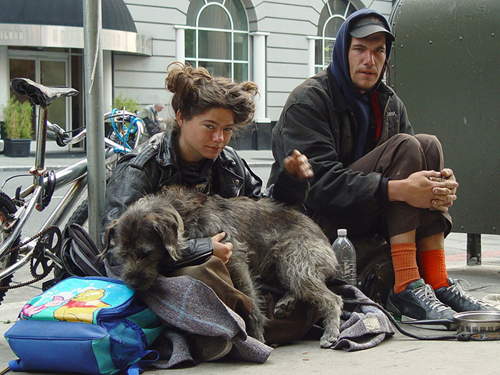 Homeless Couple With Their Dog