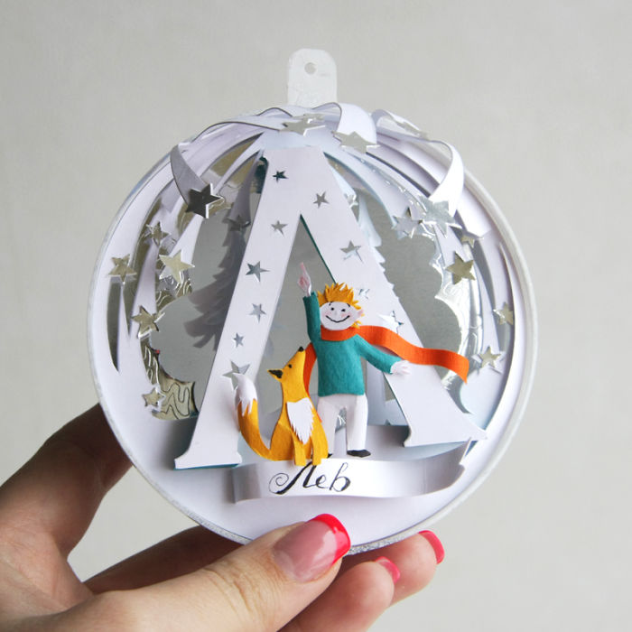 i hand cut personalized paper ornaments for my friends this
