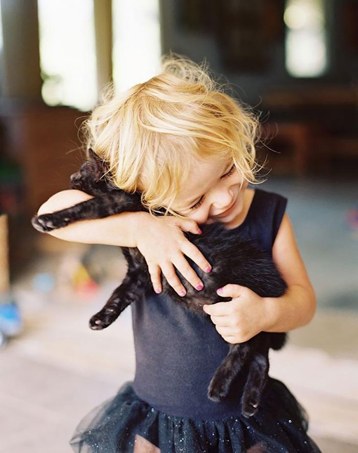 Girl With Her Kitten