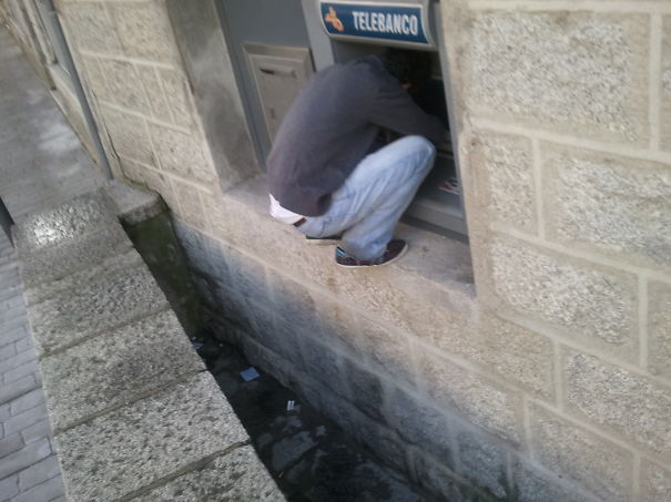 Man Withdrawing Money From Atm In Spain