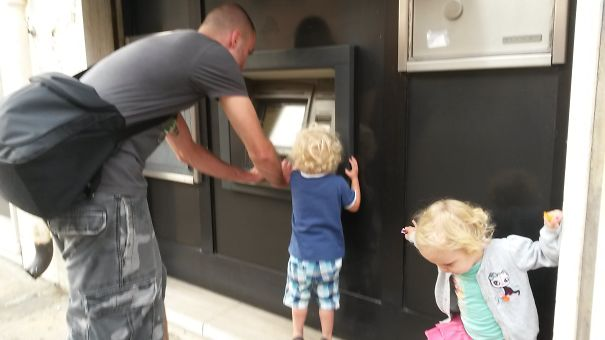 Man Withdrawing Cash From Atm In Italy
