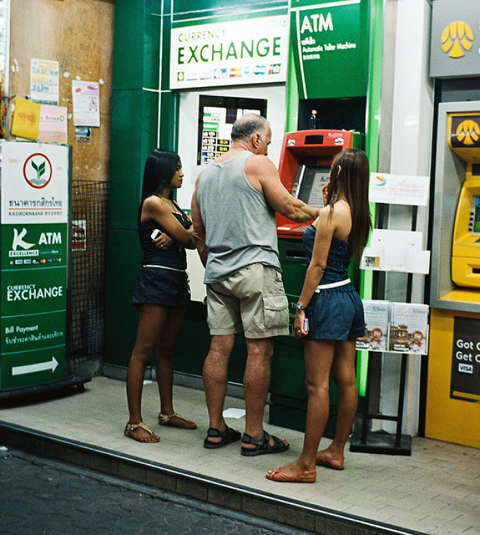 Man Withdrawing Cash From Atm In Thailand