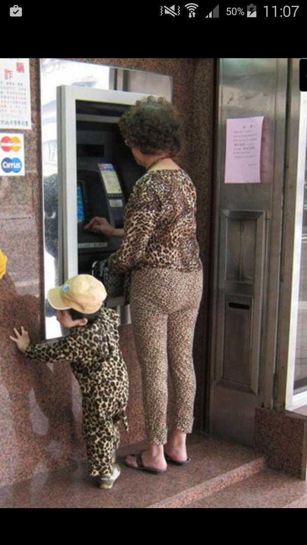 Cheetah Woman And Puma Boy Go To An Atm