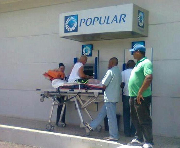Man Withdrawing Cash In The Dominican Republic
