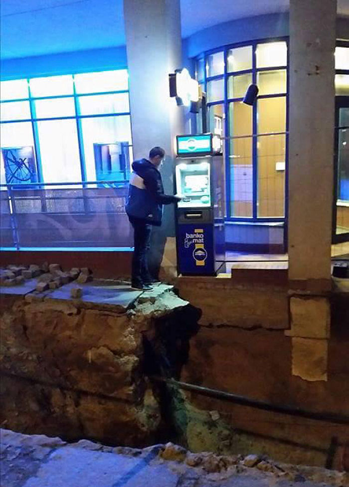 Man Withdrawing Cash From Atm In Russia