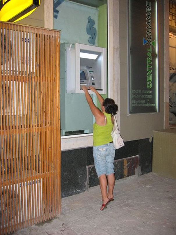 Woman Withdrawing Cash From Atm In Albania